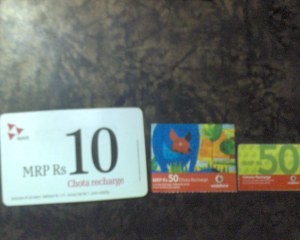 Vodafone Recharge Cards, the smallest being the latest!